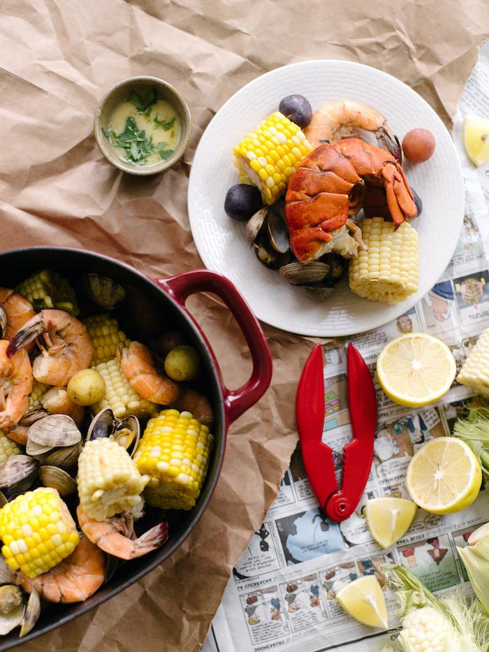 corn on the cob shrimp potatoes seafood boil recipe lemon wedges on the side