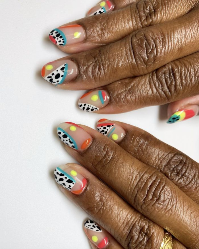 cow print abstract lines and circles in blue red orange yellow short nail designs medium length almond nails