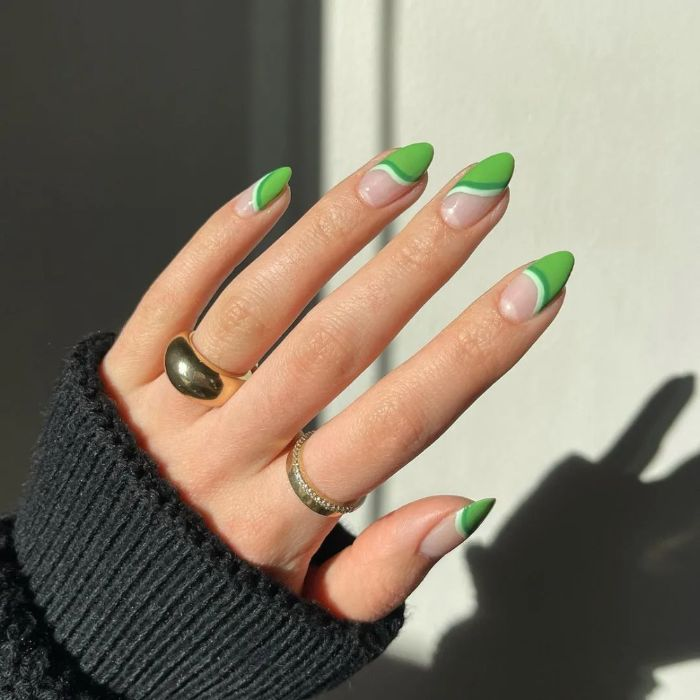 cute nail designs half of nails painted in different shades of green medium length nails