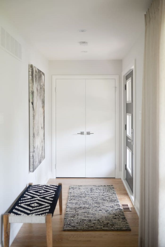decorating ideas for entry hall minimalistic design art on the wall gray rug on wooden floor