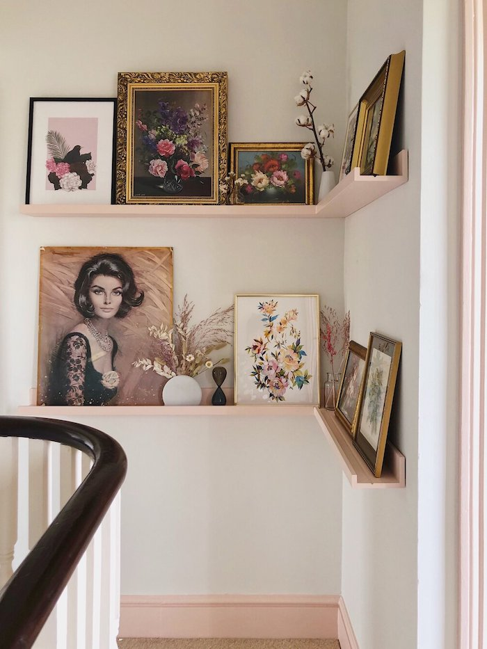 decorating ideas for stairs and hallways framed art and flowers in vases placed on floating shelves