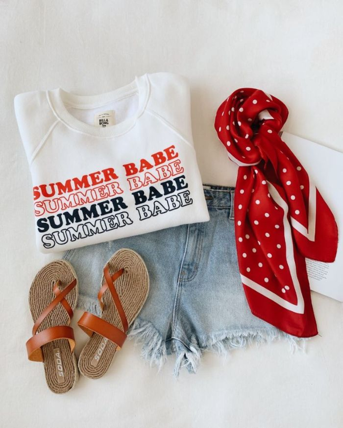 denim short white t shirt brown leather sandals red scarf 4th of july outfits for women laid out on white surface