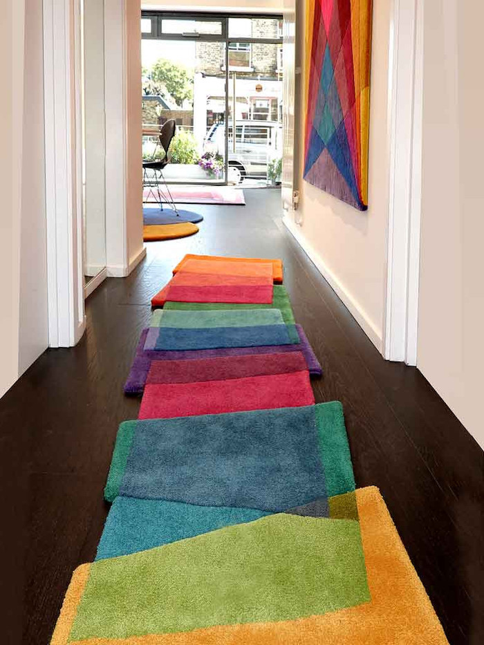 entryway design ideas super colorful rug patches stitched together in different colors dark wooden floor
