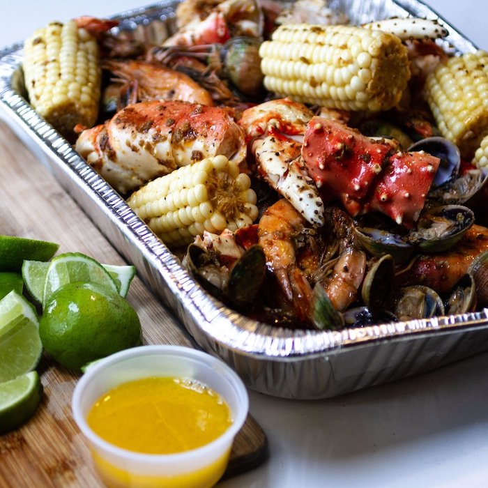 foil pan filled with corn on the cob how long to boil shrimp mussels lime wedges on the side