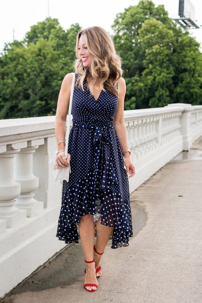 fourth of july outfits blonde woman wearing blue dress with white polka dots red sandals with heels