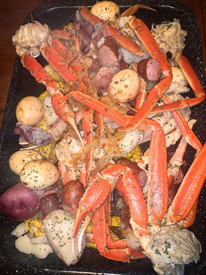 garlic butter seafood boil how to make a seafood boil with potatoes sausages onion placed in baking sheet