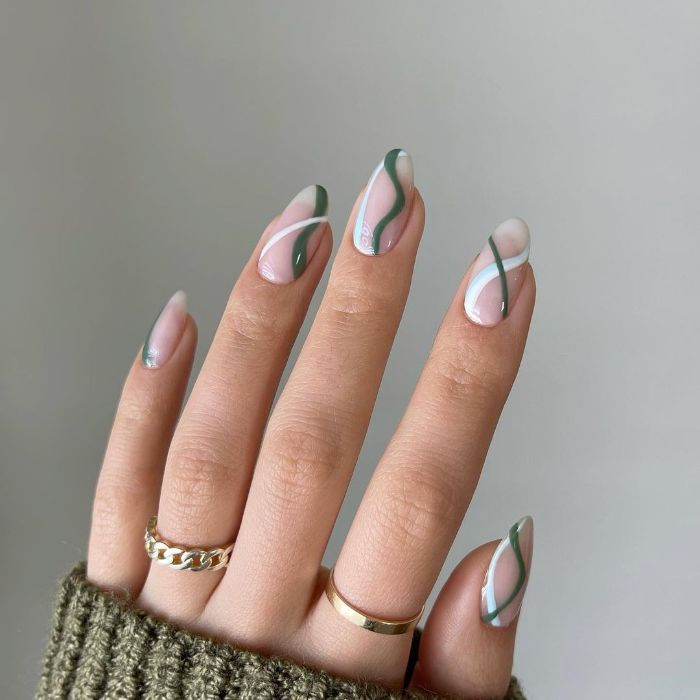 green and white swirls and lines decorations acrylic nail designs medium length almond shaped nails