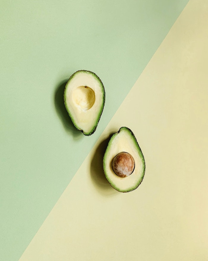 half yellow half green background home remedies for dry hair halved avocado in the middle