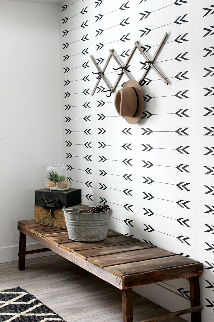 hallway wall decor colorful wallpaper on the wall wooden bench with potted plants on it