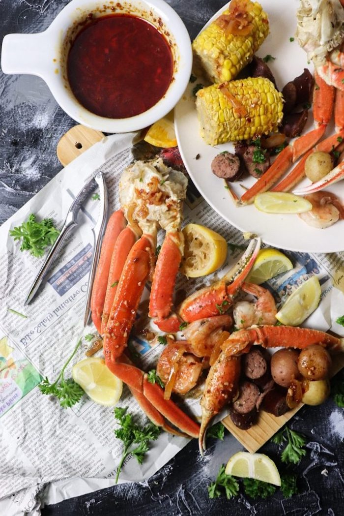 how to boil shrimp with potatoes sausages corn on the cob sauce in a bowl on the side lemon wedges