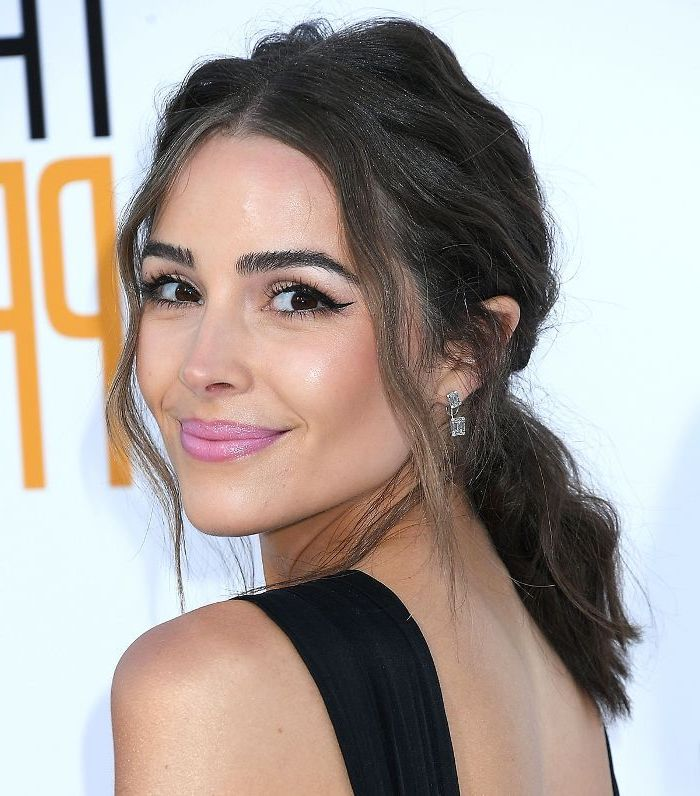 how to crimp hair brunette woman photographed on red carpet wearing diamond earrings with short hair