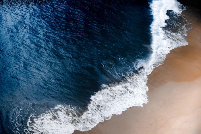 iphone beach wallpaper dark blue waves crashing into sandy beach