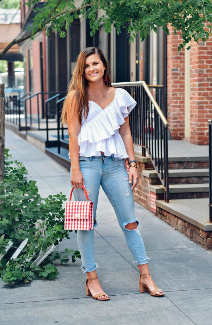 jeans white top nude sandals red and white striped bag 4th of july shirts for women worn by woman with long hair
