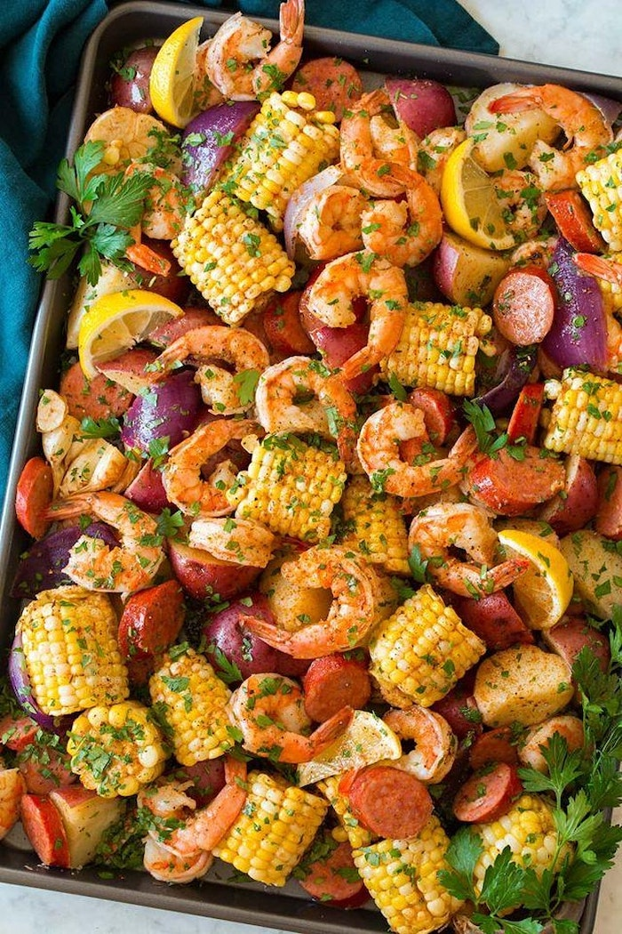 large baking sheet cajun seafood boil recipe filled with shrimp boil with potatoes sausages corn on the cob