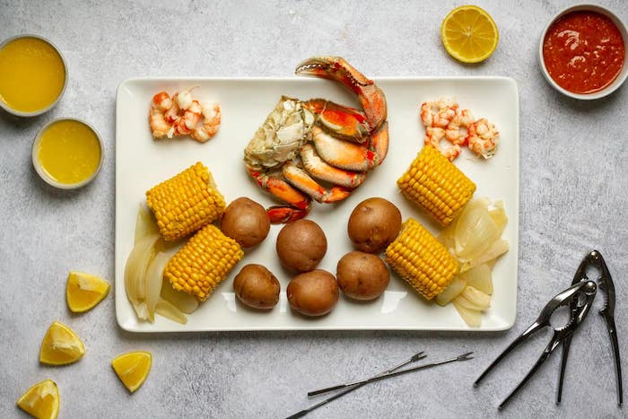 large plate in the middle of table how long to boil shrimp corn on the cob onions lemon wedges on the side