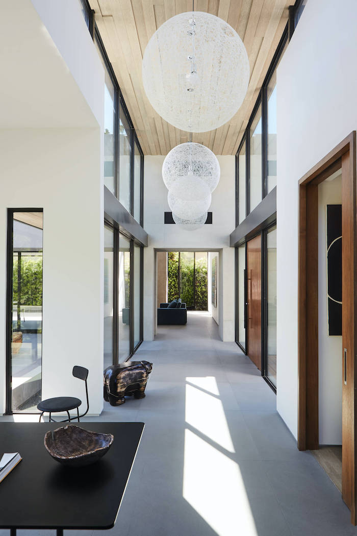 large round light fixtures decorating ideas for entry hall tall walls and windows minimalistic design wood on the ceiling