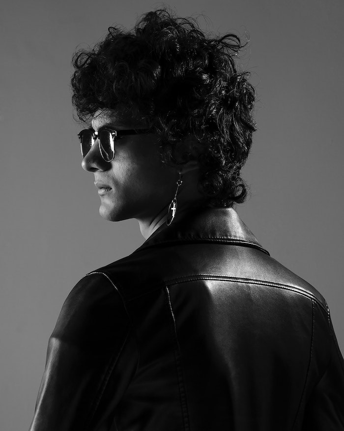man wearing black leather jacket sunglasses homemade hair mask black curly hair