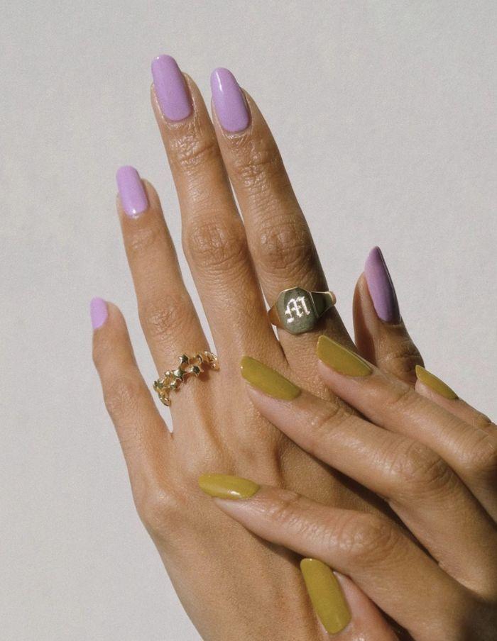 medium length nails with purple nail polish on one hand nail designs 2021 green nail polish on other hand