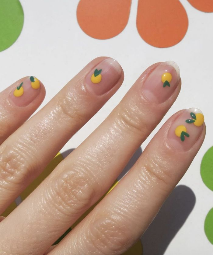 mini lemons decorations on nails with no nail polish cute nail designs minimalistic design