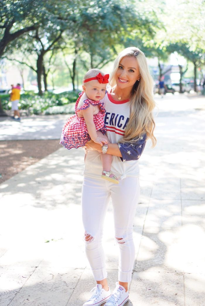 mom wearing america blouse white jeans baby wearing red and white dress 4th of july dress