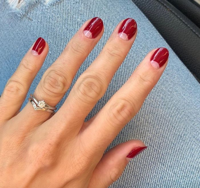 nail design ideas negative space half moons rest of nail covered with red nail polish short nails