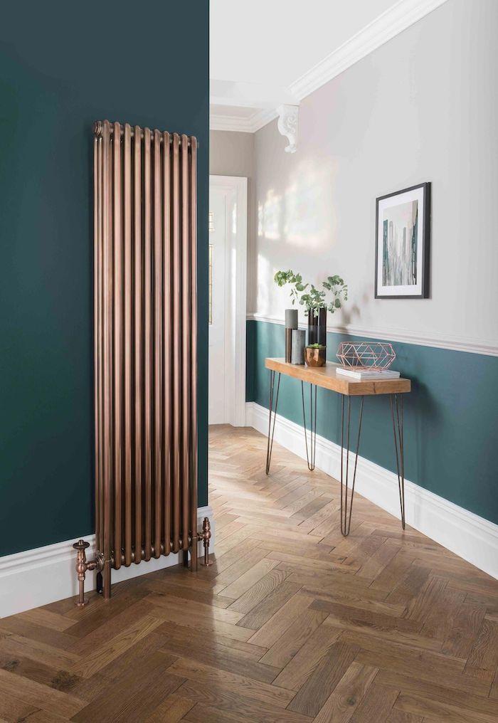 narrow hallway ideas brass metal heat fixtures dark green walls wooden floor and shelf with vases