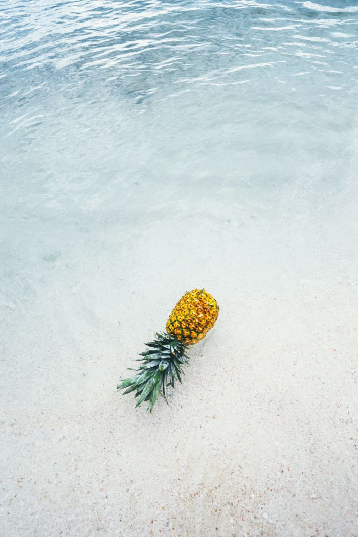 pineapple placed on beach with white sand beach desktop backgrounds water coming in