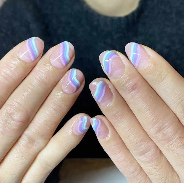 purple blue and white swirls across nails with nude nail polish gel nail designs short nails