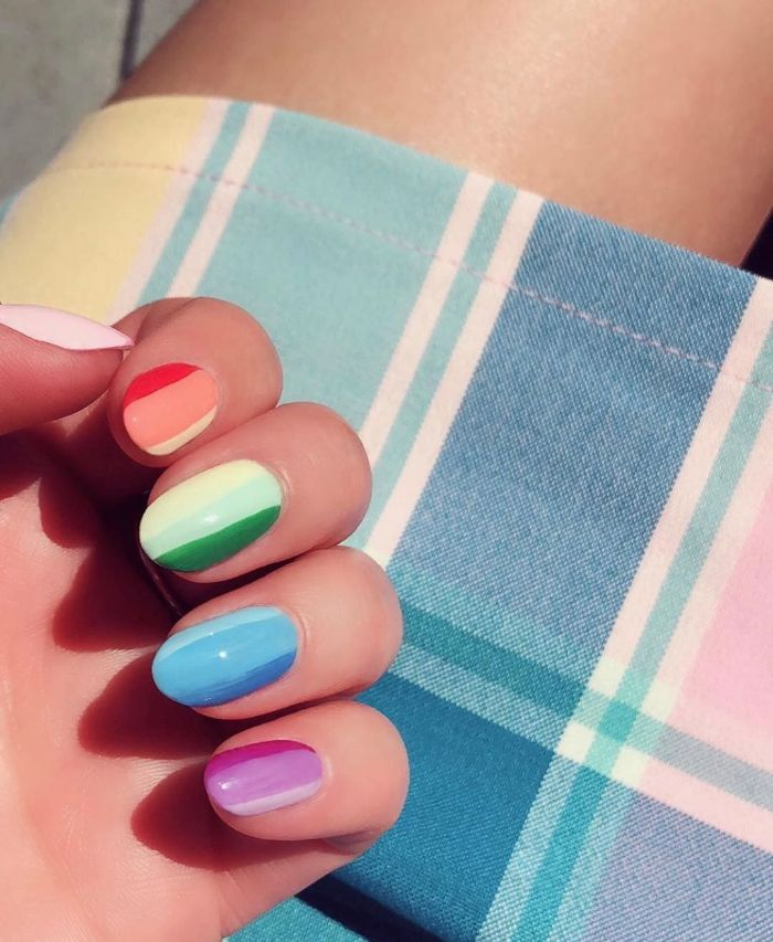 rainbow nails in red orange yellow green blue purple and pink cute short acrylic nails medium length nails