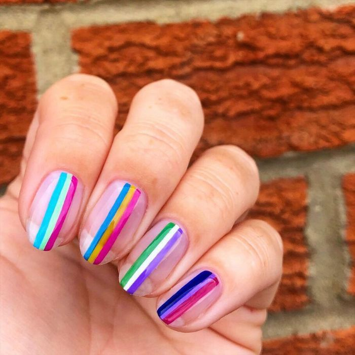 rainbow stripes on medium length nails short nail designs blue purple yellow green pink