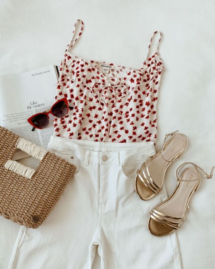 red and white top white jeans gold sandals 4th of july outfits for women laid out on white surface