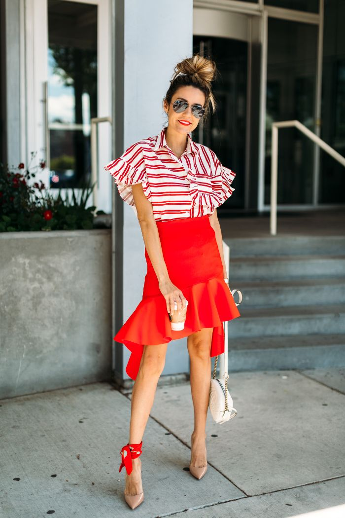 red skirt red and white striped blouse 4th of july shirts for women blonde hair in high messy bun