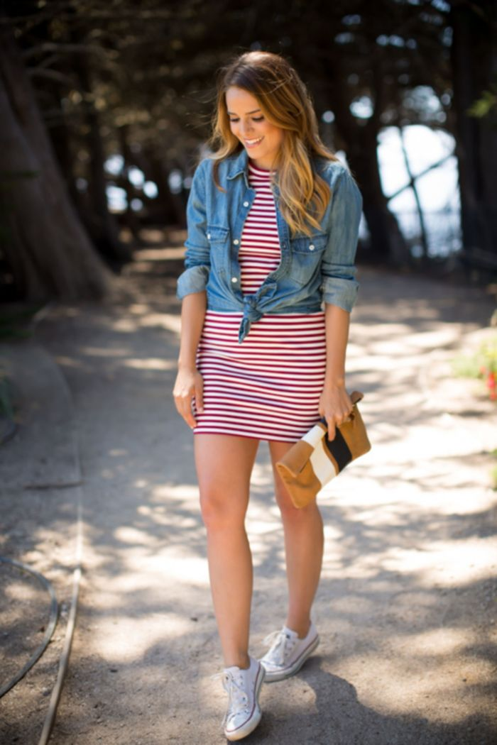 red white striped dress denim shirt over it converse sneakers worn by brunette woman 4th of july clothes