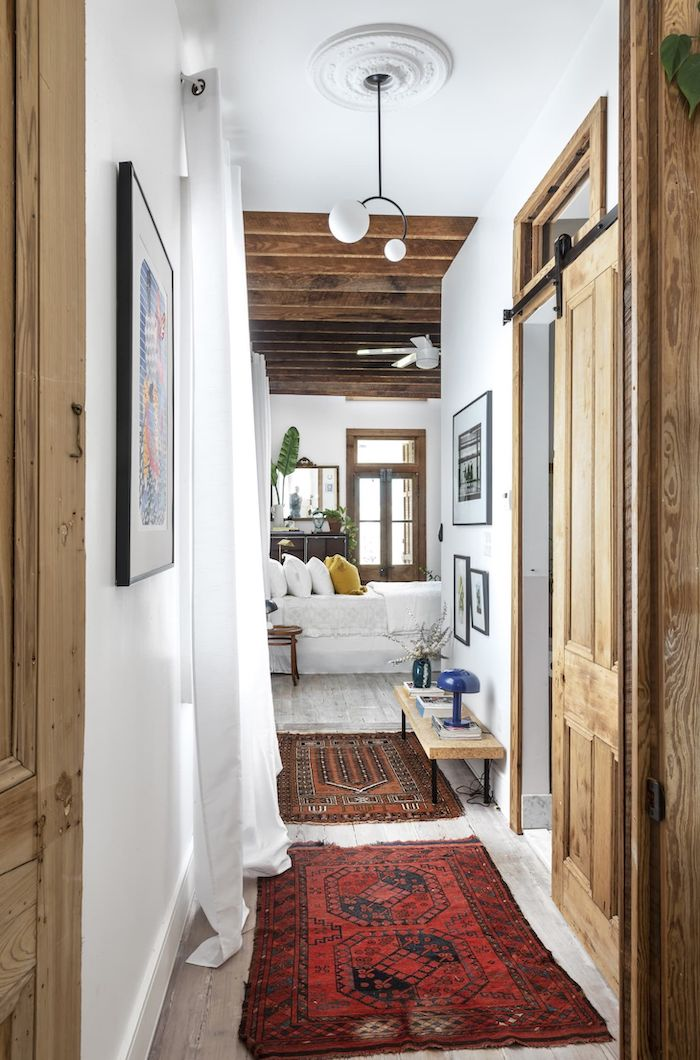 rustic farmhouse decor entryway wall decor wooden doors colorful rugs on white wooden floor