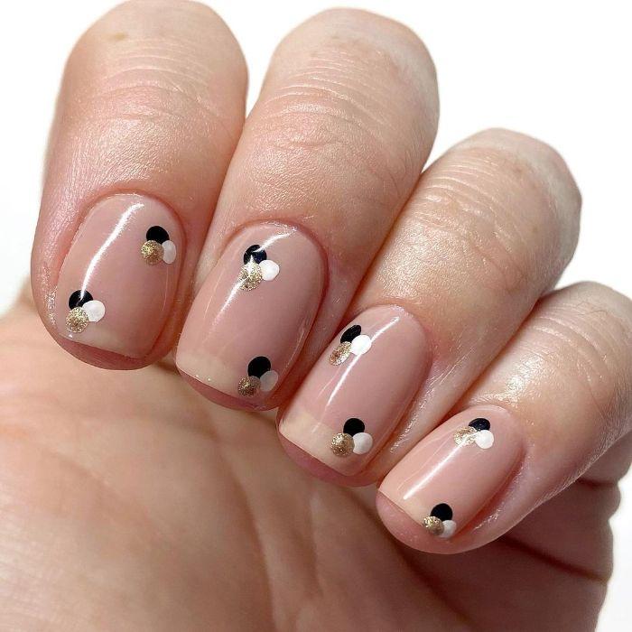 small black gold and white dots on nude nail polish on short nails summer nail designs