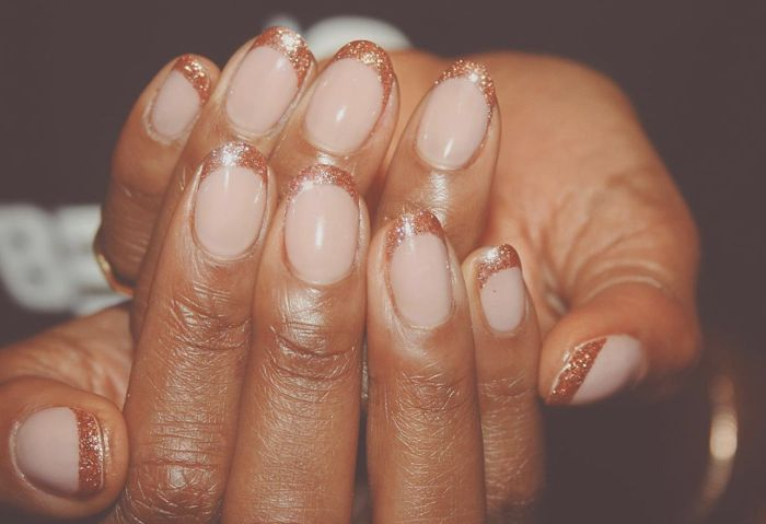 spring nail designs short nails with nude nail polish gold glitter french manicure
