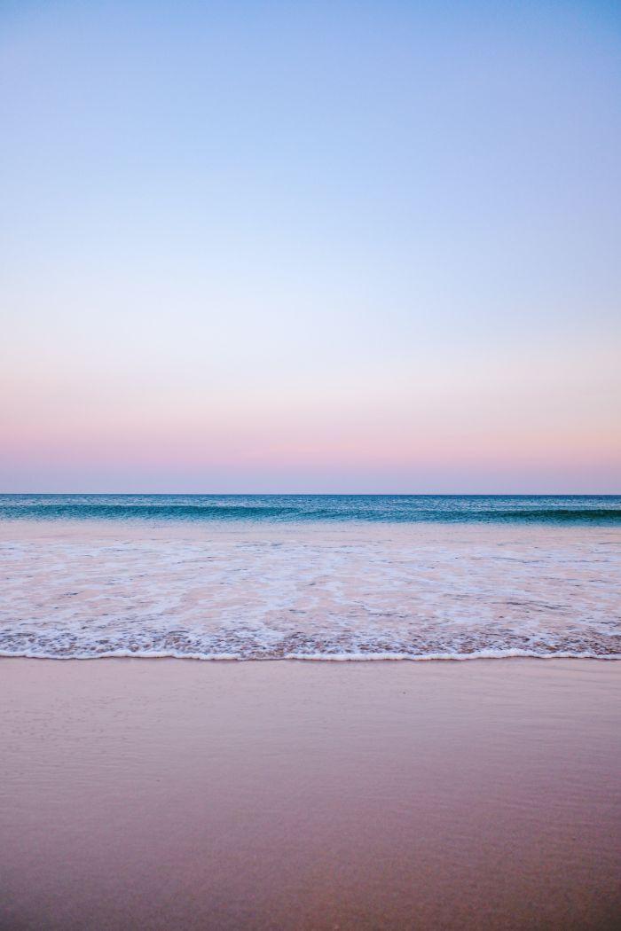 sunset photo of waves crashing into the sand beach desktop backgrounds sunset sky
