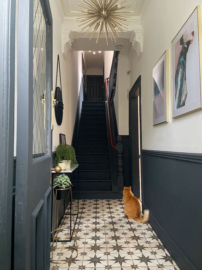 tiled floor in black and white dark blue staircase decorating ideas for entry hall framed art on the wall