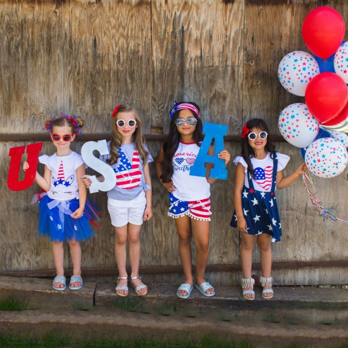 usa letters 4th of july outfits four kids holding them dressed in red white and blue patriotic outfits