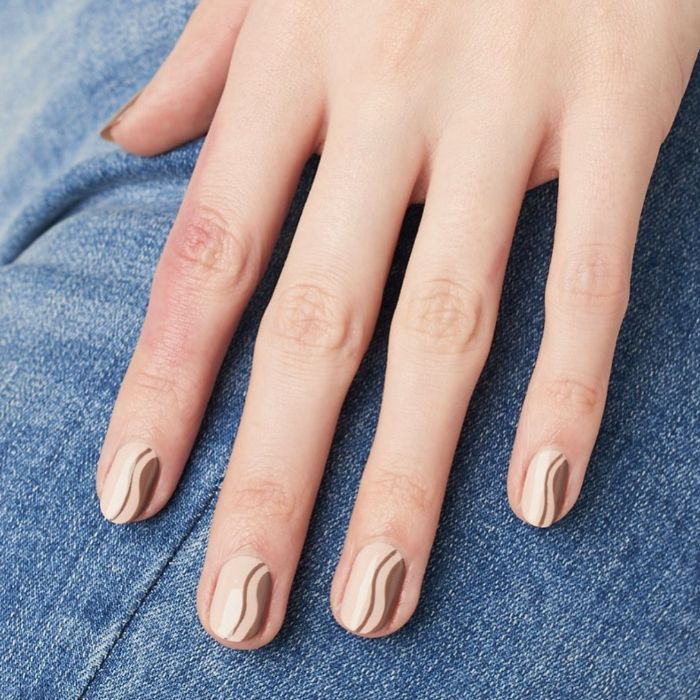 white and brown swirls on nude nail polish nail design ideas short squoval nails