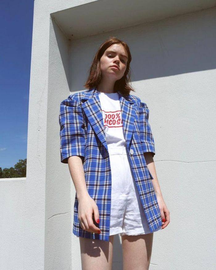 woman wearing white shorts and t shirt fourth of july shirts blue checkered oversized blazer