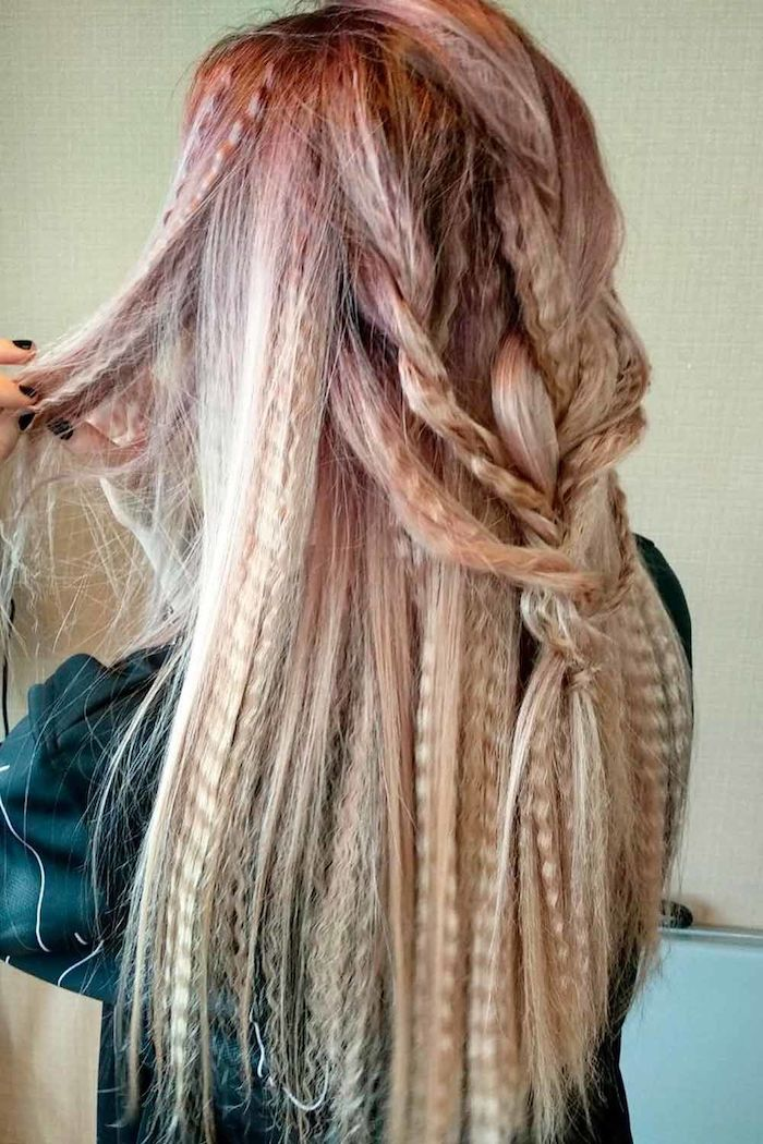 woman with long hair dyed in blonde and pink half braided 80s crimped hair wearing green top