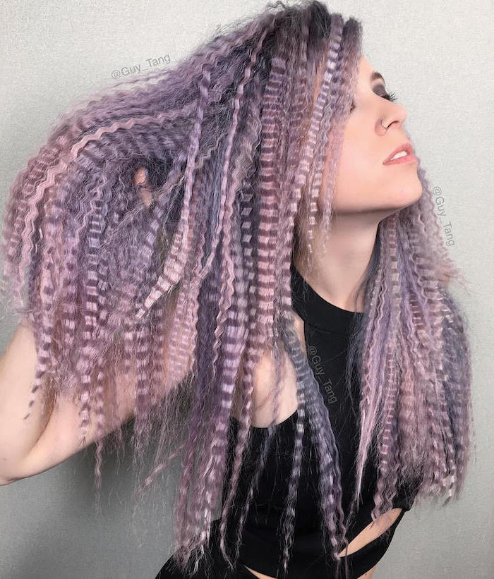 woman with long hair dyed in pink and purple crimped hairstyles wearing black top