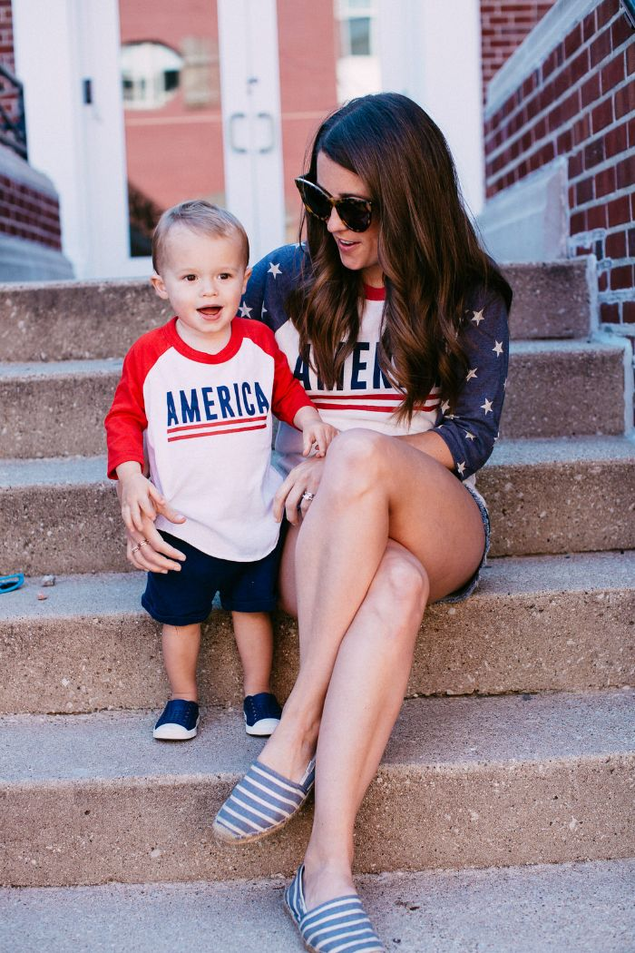 woman with toddler wearing america sweatshirts 4th of july outfits for women sitting on stairs