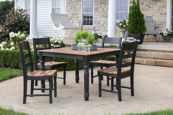 wooden table and chairs lemonade pitcher and glasses in the middle farmhouse garden table