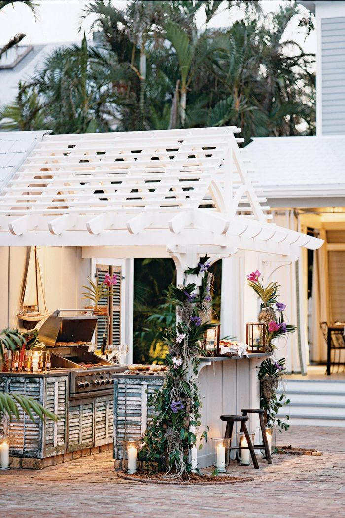 bar decorated with exotic flowers backyard design ideas barbecue under white wooden pergola