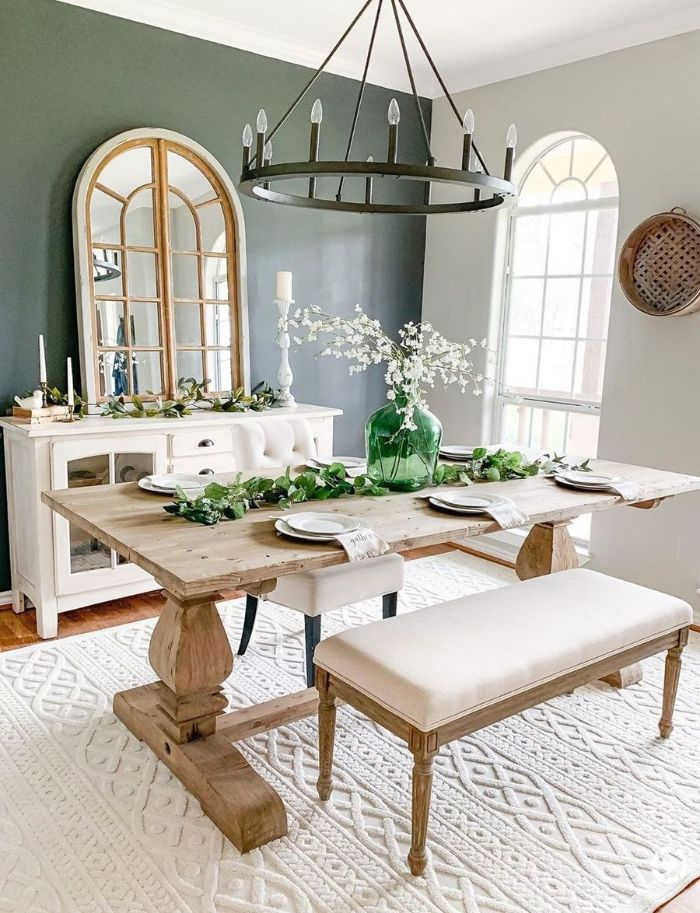 bench next to wooden table placed next to cupboard with mirror on it dining room design ideas