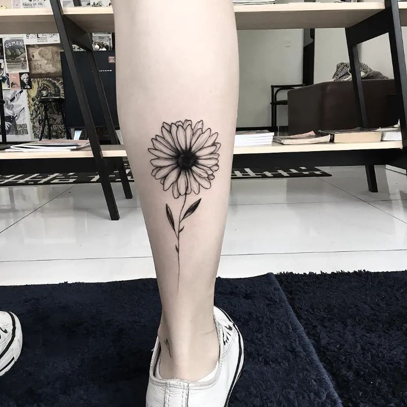 black and white small sunflower tattoo back of leg