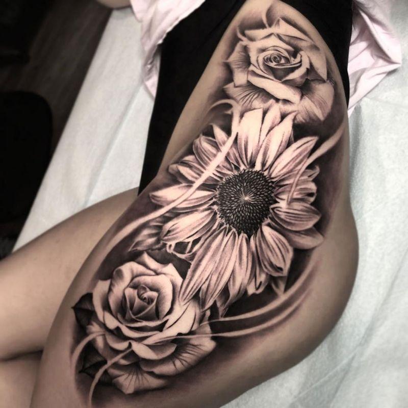 black and white sunflower tattoo side thigh tattoo