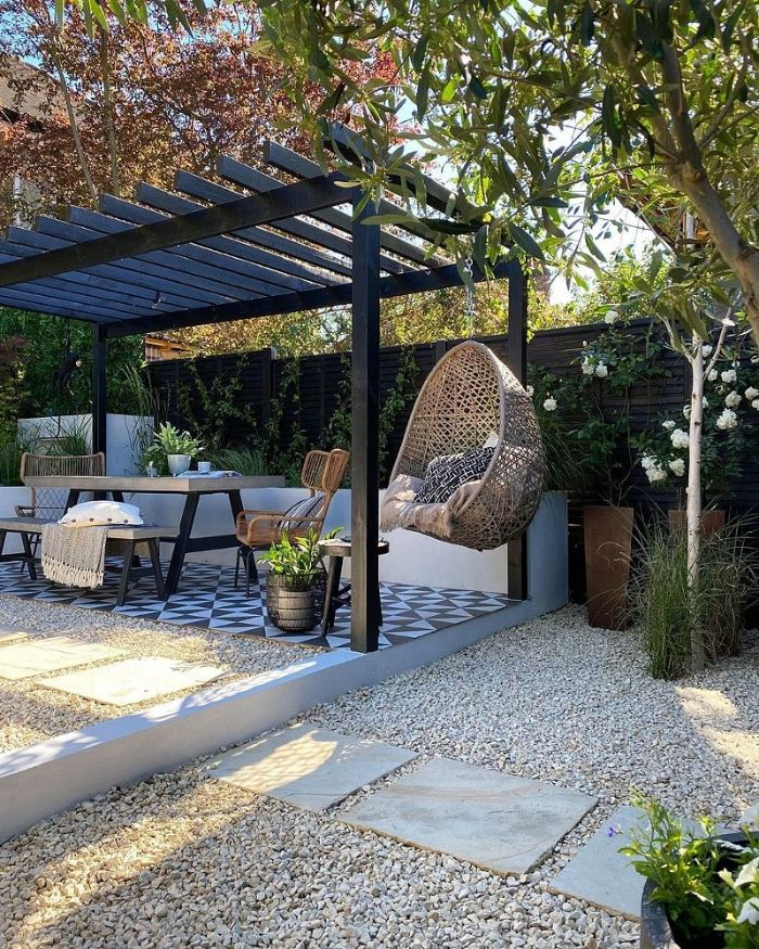 black wooden pergola wooden table chairs bench and swing underneath backyard patio ideas on a budget black and white tiles